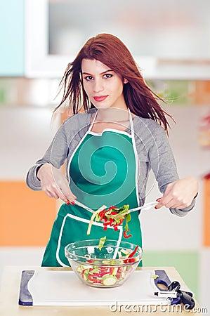 Glamorous cook preparing salad