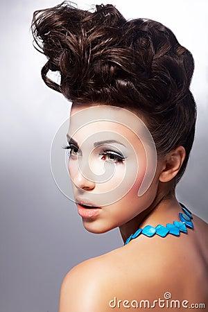 Glamorous female. Luxury coiffure and make up