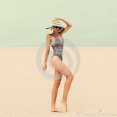 Free Glamorous Lady In Fashionable Swimsuit And Accessories At The Be Stock Photo - 58944430