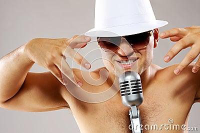 Glamorous man sing a song