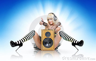 Glamorous sexy party girl with speaker