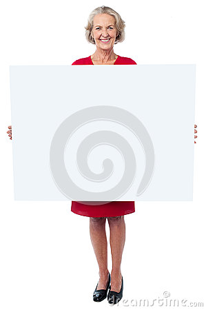 Glamorous woman holding blank ad board