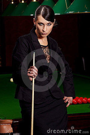 Glamorous woman witn cue