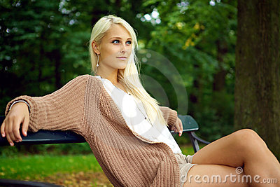 Glamorous Young Lady Relaxing In Nature
