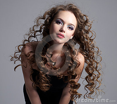 Glamour face of teen girl with long curly hair