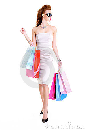 Glamour female with shopping bags in hands