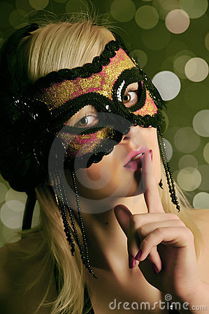 The glamour girl in a mask