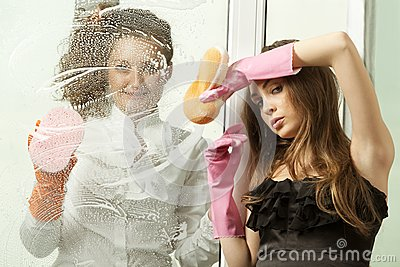 Glamour girls washing the window