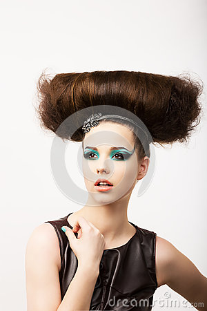 Glamour. Vitality. Portrait of Unusual Brunette with Extraordinary Festive Hairdo