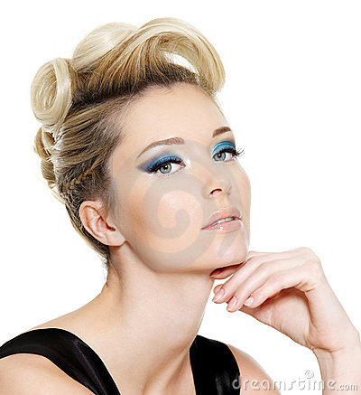 Glamour woman with blue eye make-up and hairstyle