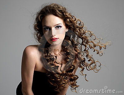 Glamour woman with curly long hair