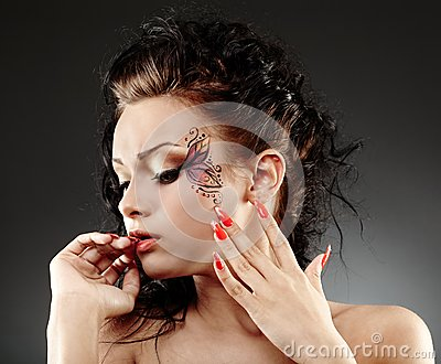 Glamour woman with facial painting