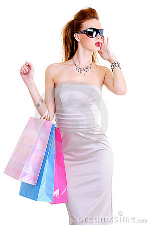 Glamour young European woman with purchases