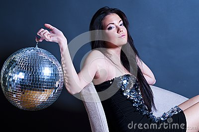 Glamourous young girl with disco ball