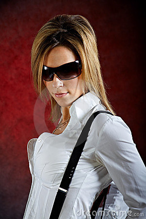 Glamourous young woman wearing sunglasses