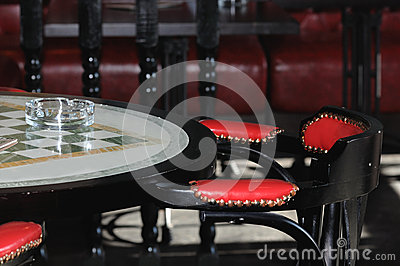 Glass ashtray on a table in the bar