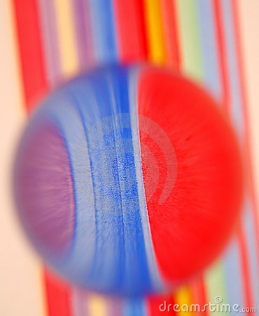 Glass ball on colored stripes