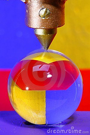 Glass ball under sharp point