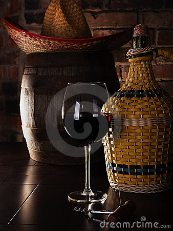 Glass, barrel and a bottle of red wine
