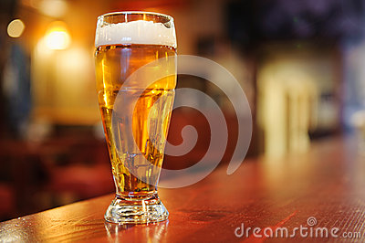 Glass of beer on the bar Stock Photo