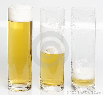 A glass of beer becoming empty
