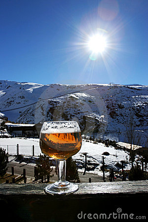 Glass of beer or lager on wall in the Sierra Nevada Ski resort i
