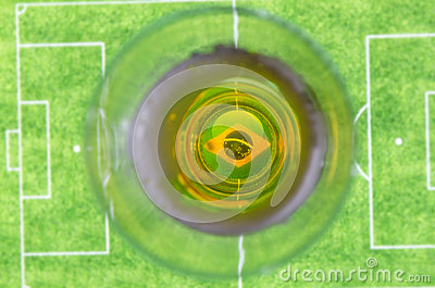Glass of beer and soccer field