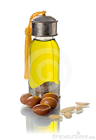 Free Glass Bottle Of Argan Oil With Nuts And Seeds Stock Image - 24591691