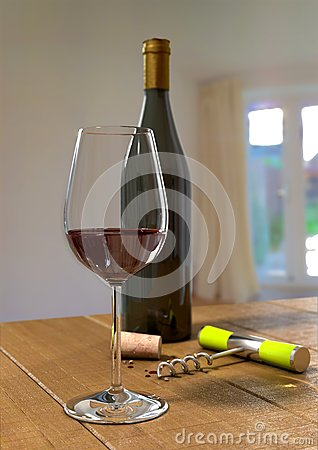 A glass and bottle of red wine