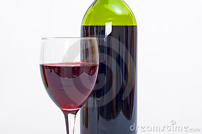 Glass and bottle of red wine with white background