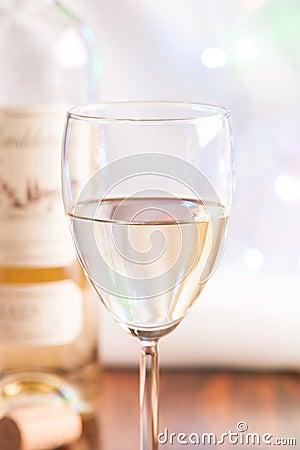 Glass and bottle white wine on blink light