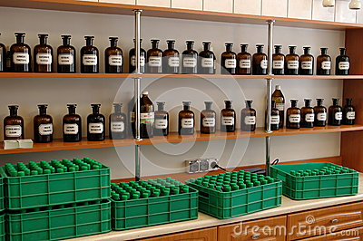 Glass bottles with herbal medicines and tinctures Editorial Stock Photo