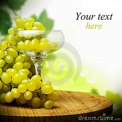 Glass with Bunch of ripe grapes