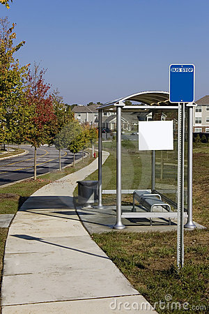 Glass Bus stop in suburban area