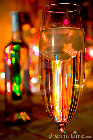 A glass of champagne on  lights background