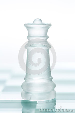 Glass chess queen is standing on board