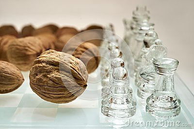 Nuts improve brain efficiency visualization - chess, chessboard with nuts Stock Photo