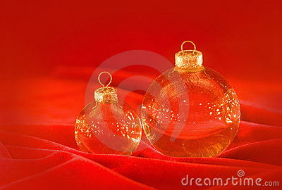 Glass christmas balls on red