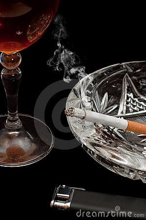Glass of cognac and cigarette