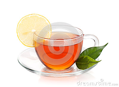 Glass cup of black tea with lemon slice