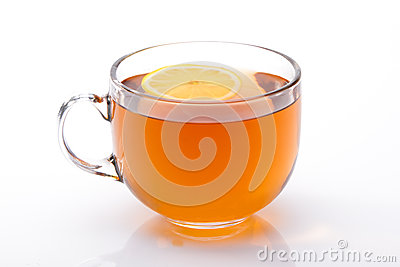 Glass cup of black tea with lemon