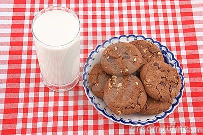 Glass cup of milk and cookies