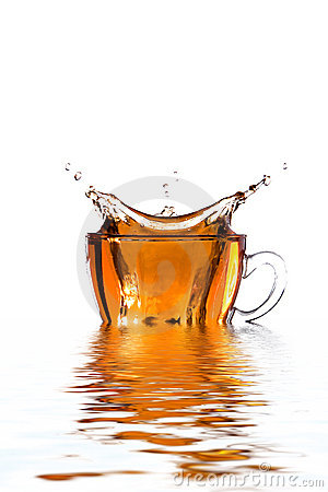 Glass cup of tea with splash