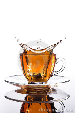 Glass cup of tea with splash out