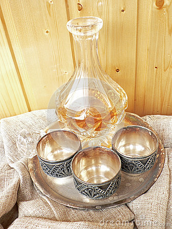 Glass  decanter wint three melchior cups