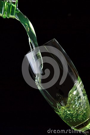 Glass of drink poured