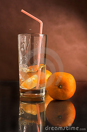 Glass of a drink with a tangerine