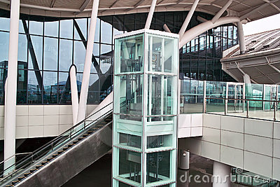 Glass elevator and escalator