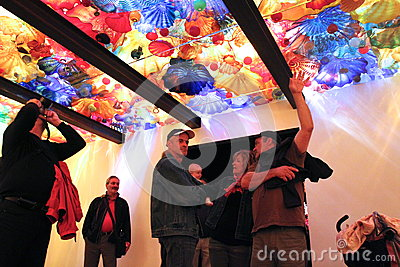 Glass exhibition visitors Editorial Stock Photo