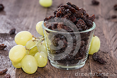 Glass filled with Raisins (and Grapes)